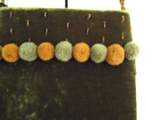 Velvet Fair Trade evening bag with pompoms on bead chain