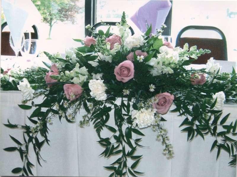 Top table long and low arrangement garlands florists ltd